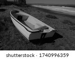 A Small Blue And White Dinghy...