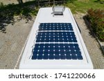 Small photo of Camper van solar roof panels with skylight top view Motorhome