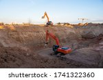Small photo of Digging the pit foundation a hole with excavator. Earthwork in excavation and backfilling of soil upto required depth is required for construction of trenche. Construction machinery for earthmoving