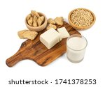 Soy foods collection with dry soy meat, soybeans, soy milk and tofu isolated on white background. Soy products mix with soya milk, bean curd, TSP