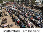 Small photo of MUMBAI/INDIA - MAY 26, 2020: Migrant workers with their family stand in queue to board a bus to take them to railway terminus for boarding a special train back home during a nationwide lockdown.