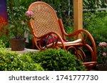 Wicker Chair In The Garden....
