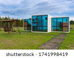 Small photo of 23.05.2020 Russia, Sayzovo farmstead. Modular prefabricated houses made of panels with large panoramic windows.