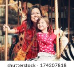 a young mother and her daughter ... | Shutterstock . vector #174207818