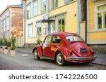 A Red Volkswagen Beetle Car...