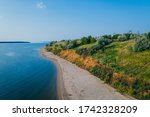 river shore with beach and clay ... | Shutterstock . vector #1742328209
