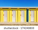 Bright Yellow Beach Huts In...