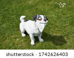 Kitschy dog figure on lawn with ...