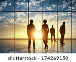 silhouettes of businesspeople... | Shutterstock . vector #174269150