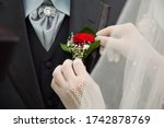 Put Corsage On The Groom's Suit