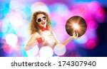 young pretty girl dj at disco... | Shutterstock . vector #174307940