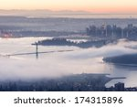 Fog over Lions Gate Bridge in a Vancouver Winter Morning - stock photo