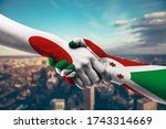 shaking hands japan and burundi   Shutterstock . vector #1743314669