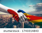 shaking hands japan and congo   Shutterstock . vector #1743314843