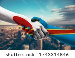 shaking hands japan and congo   Shutterstock . vector #1743314846