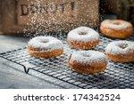 Falling powder sugar on donuts - stock photo