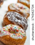 Closeup of freshly baked colorful donuts - stock photo