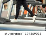 people at the gym exercising.... | Shutterstock . vector #174369038