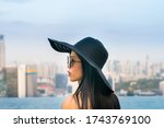 young woman in a roof top... | Shutterstock . vector #1743769100