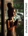 Welcoming Wooden Statue Of...