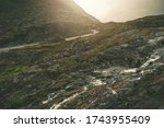 Scenic Scandinavian Route. Alpine Road in South West Norway. Norwegian Raw Rocky and Rainy Landscape. - stock photo