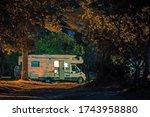 Motorhome Vacation Travel. Calm Camping Night inside RV Camper Van. Recreational Vehicle Traveling Theme. - stock photo