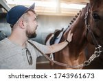 Caucasian Horse Passionate in His 20s and His Animal. Equestrian Facility Theme. - stock photo