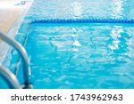 Water Sports and Recreation. Professional Swimming Pool with No People Close Up. Blue Ceramic Tiles. - stock photo