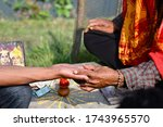 Small photo of Scenery portrait of the Hindi Palmist fortune teller