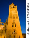 Night view of the bell tower La Giralda of the cathedral of Seville, Spain.