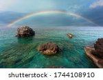 Rainbow appears obove rocks in...