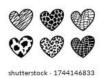 black animal print hearts on a...   Shutterstock .eps vector #1744146833