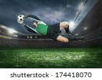 football golkeeper with ball in ... | Shutterstock . vector #174418070