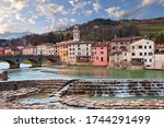 Santa Sofia, Forli Cesena, Emilia Romagna, Italy: landscape of the ancient town with the picturesque houses on the river shore and the Apennine mountains on background