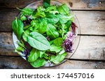 fresh green salad with spinach... | Shutterstock . vector #174457016
