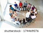 businessman addressing multi... | Shutterstock . vector #174469076