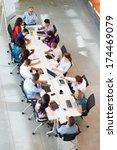 businessman addressing meeting... | Shutterstock . vector #174469079