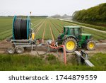 A Tractor Taking Water From A...