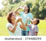 happy family of three drinking...   Shutterstock . vector #174488294