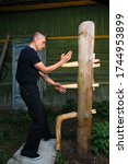 Small photo of Wing Chun-martial art, martial arts, fighter, training, Wooden Dummy
