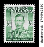 Small photo of Southern Rhodesia - circa 1937 : Postage stamp printed by Southern Rhodesia, that shows portrait of king George VI, circa 1937.