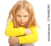 Small photo of Little sad and angry child. Isolated on white background