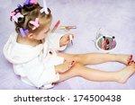 little girl painting nails... | Shutterstock . vector #174500438