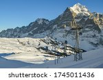Grindelwald, Switzerland - December 30, 2019: Cable from Grindelwald to Grindelwald First in Switzerland during sunny day in December 2019 - stock photo