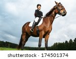 Cheerful Young Woman Ridding...