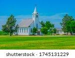 A Steepled White Church Sits I...