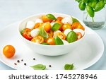 caprese salad with yellow and... | Shutterstock . vector #1745278946