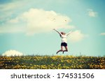 happy woman jumping on blossom... | Shutterstock . vector #174531506