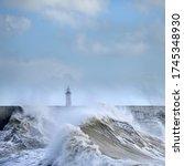 Huge Waves Crash Over Harbour...