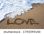 Love Words In The Sand Of The...